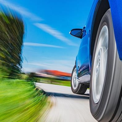 blue car speeding on road